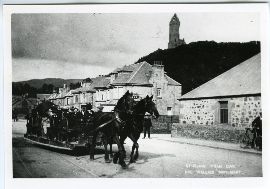 Stirling Tram Car Service below Wallace Monument